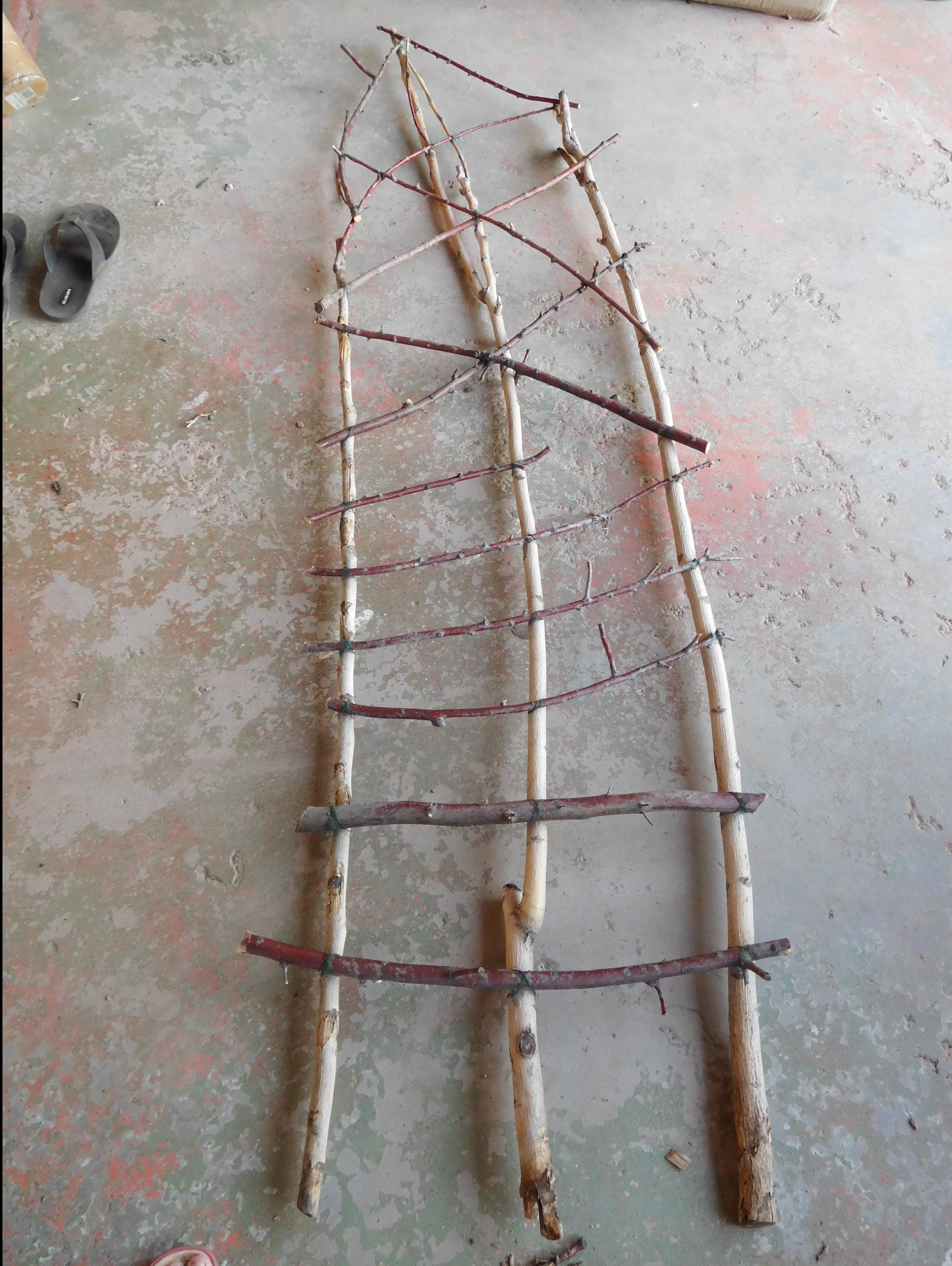 How I Made a Rustic Trellis Using Sticks from the Yard and Wire ...